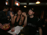 Janet Sanders  of Lousiville and Allan Golod, Of LIttleton react to the Sox's scoreat the Public...