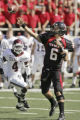 TXMO111 - Texas Tech quarterback Graham Harrell (6) passes as Texas A&M defender Danny Gorrer...