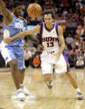 PNU101 - Phoenix Suns guard Steve Nash (13) chases down the ball as Denver Nuggets forward...