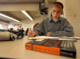 (Denver, Colo., August 26, 2004) Student Juan Verastegui (cq), 14, works on homework in class at...