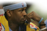 JOE629 Denver Nuggets Allen Iverson watches his team play against the San Antonio Spurs in the...