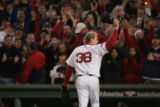 [RMN568] Red Sox pitcher Curt Schilling tips his hat to the right field crowd after being pulled...