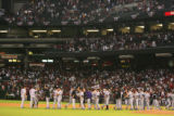 Rockies players congratulate each other at the end of their 11-inning, 2-1 victory in game 2 of...