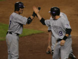 Caption:  Winning run is walked in against the Arizona Diamondbacks in game two of the best of...