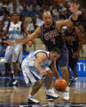 United States basketball player Carlos Boozer defends Argentina's Ariel Alejandro Mntecchia, #6,...