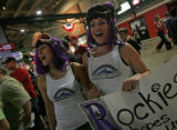 Caption:  Colorado Rockies fans Tricia Wilson (CQ), 23, left,  and Jamie Robinson (CQ), 25, cheer...