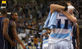 American basketball player Carmelo Anthony, left, watches Argentina's Luis Alberto Scola, #11,...