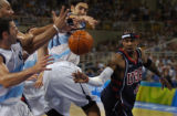 American basketball player Allen Iverson, right, loses the ball to a gaggle of Argentina's...
