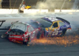 GAJB113 - NASCAR drivers Dale Earnhardt Jr., (8) and Jamie McMurray (26) crash in the final laps...