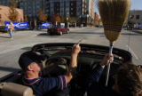 Boston fans Bob Louis (cq, left), and Bill Louis (cq, right) drive around downtown Denver, Colo.,...