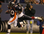 (Denver, Colo., August 27, 2004) Cornelius Anthony is tackled near the goalline by KaRon Coleman...