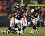 (Denver, Colo., August 27, 2004) Cornelius Anthony runs towards the goalline after stripping the...