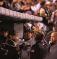 [6802]  Colorado Rockies Brad Hawpe is congratulated in the dugout by teammates after his solo...