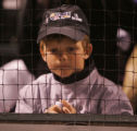 [8120]  A Colorado Rockies fan watches as the Boston Red Sox defeat the Rockies 4-3 in Game 4 to...