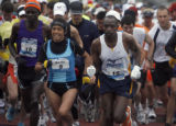 (middle left) Number 5, elite full marathon runner Martha Tenorio (cq) from Quito, Ecuador takes...