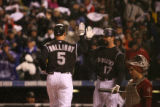 Todd Helton congratulates Matt Holliday after Holliday's home run in the first inning of Game...