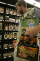 Jack Keith (cq) from Wheatridge, searches for the perfect brew at Applejack Liquor  Store Thursday...