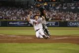 Diamondbacks Stephen Drew slides across home plate, scoring on a double by Eric Byrnes in the...