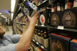 Rob Tonnsen  (cq) from Golden, searches for the perfect brew at Applejack Liquor  Store Thursday...