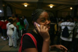 Liberti Reid, (cq), freshman, works her cellphone in the hallway after classes are complete. East...