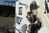DM0124     Artist Adam Moorhead puts the finishing touches on a 20-foot mural of Colorado Rockies'...