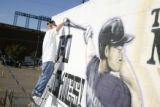 DM0204     Artist Adam Moorhead puts the finishing touches on a 20-foot mural of Colorado Rockies'...