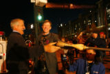 DM1334     Denver Mayor John Hickenlooper and Colorado Governor Bill Ritter touch a broom for luck...
