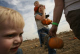 MJM252  Grayson Bennett, 2, of Lakewood, Colo., left, stands by as his mother, Shannon Bennett...