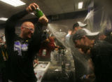 Matt Holliday sprays champagne on other members of the Colorado Rockies in the locker room...