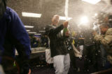 Matt Holliday sprays champagne in the locker room after the Rockies beat the Arizona Diamondbacks...
