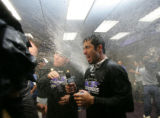 Ryan Spilborghs gets doused by champagne in the locker room following the Rockies' 6-4 win in the...