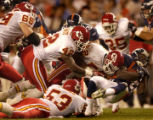 (DENVER, COLO., SEPTEMBER 12, 2004) - Denver Broncos' #45, Roc Alexander, right, is wrapped up by...