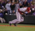 Diamondback first baseman Conor Jackson can't handle a ball hit by Willy Taveras in the fourth...