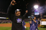 Kazuo Matsui celebrates after wininng the National League Championship Series 6-4 against the...
