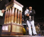 The National League Championship trophy sits in front of Matt Holliday and his son Jackson after...