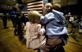 """I belong to you,"" said Captain Steve Schmidt to his son Brycen, 4, right, as he hugged..."