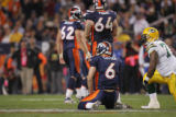 [JOE582]  Denver Broncos quarterback Jay Cutler kneels on the turf after his third down pass to...