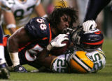 #58 Nate Webster stops #25 Ryan Grant in the 2nd as the Broncos host the Green Bay Packers at...