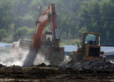 Old buildings being  demolished at the Aurora Organic Dairy Farm in Platteville on Friday...