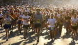 Runners begin the Pikes Peak Marathon in Manitou Springs August 17, 2003. The winner in the men's...