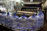 Anthony Robins (cq) operates the bottle cleaning system at Deep Rock Water Company, 2633...