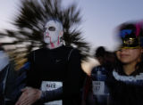 Jason Gerard (cq, left) and Jessica Gerard (cq, right) prepare to begin the Halloween Hustle 5K...