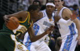 [EPS101] Denver Nugget forward Carmelo Anthony guards Seattle's star rookie Kevin Durant, left, in...
