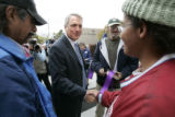 0165 Governor Bill Ritter greets Shonna Perrymond, CQ, 32, right, and a few other homless people...