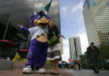 Jolene Kopatich (cq) poses with Dinger, the Colorado Rockies mascot on the mall in downtown...