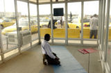 (DENVER, Colo., August 30, 2004) Abduhl Hajy, Somalia, and muslim, takes time out to pray in a...