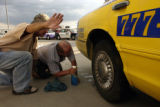 (DENVER, Colo., August 31, 2004) Mike from Russia, holds out a directional hand as Stan, a driving...