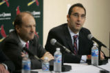 MOJR104 - John Mozeliak, right, speaks at a news conference announcing him as new general manager...
