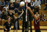 Mountain Vista's #9 Hayley Mommer goes up against Berthoud's  #11 Courtney  Woodruff  at Berthoud...