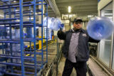 George Rivera (cq) loads empty five gallon  bottles into a cleaning rack at the Deep Rock Water...